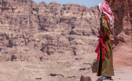 Petra, Jordan - 19th April 2014 - one of the main attractions of Jordan are the colorful inhabitants. Here in particular a local man dressed in typical clothes Foto de archivo