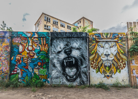 Berlin, Germany - street art and paintings are one of the most prominent landmarks in Berlin. Here in particular a fine example of the citys wall painting