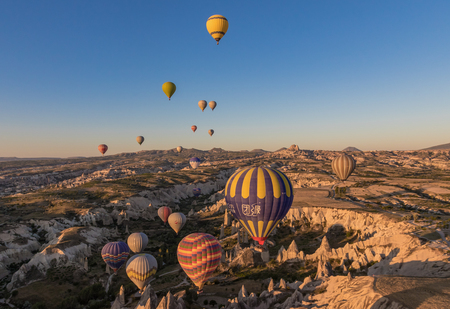 Goreme, Turkey - A Unesco World Heritage site, Goreme and Cappadocia are famous also for the spectacular ballooning excursions. Here in particular a sunrise ballooning 報道画像