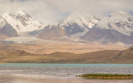 Tashkurgan, China - located 3,500m above the sea level, along the road between Kashgar and Tashkurgan, the Kala Kule Lake offers some amazing sights and colors