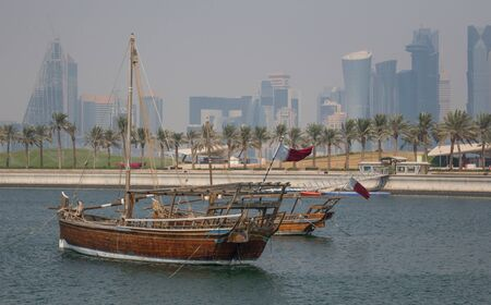 Doha, Qatar - located at the Eastern side of the Corniche, the Dhow Harbor is one of the main landmarks of Doha, and show a full display of traditional boats and vessels Stock Photo