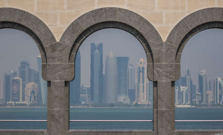 Doha, Qatar - probably the most notable landmark in Doha, the Corniche is a waterfront promenade extending for seven kilometers along Doha Bay. Here in particular its skyline Editorial