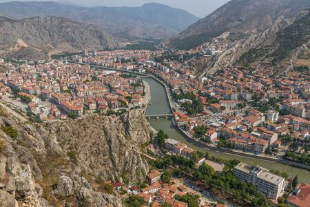 Amasya, Turkey - Amasya is known the typical Ottoman buildings. Here in particular a glimpse of its wonderful Old Town seen from the surrounding hills Imagens