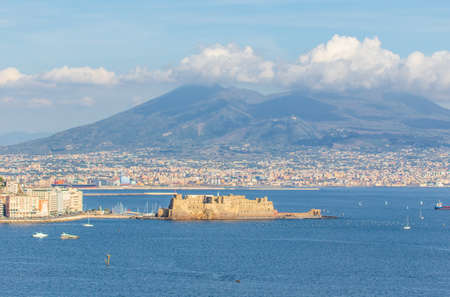 Naples, Italy - built during the 15th century, Castel dell'Ovo (Egg Castle) is a seaside castle located in the Gulf of Naples. Here the fortress with Mount Vesuvius in the background