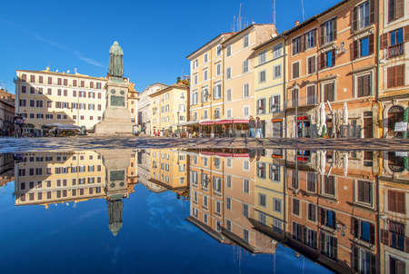 Rome, Italy - in Winter time, frequent rain showers create pools in which the wonderful Old Town of Rome reflect like in a mirror. Here in particular Campo de Fiori