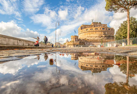 Rome, Italy - in Winter time, frequent rain showers create pools in which the wonderful Old Town of Rome reflect like in a mirror. Here in particular Castel Sant'Angelo