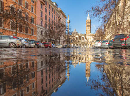 Rome, Italy - in Winter time, frequent rain showers create pools in which the wonderful Old Town of Rome reflects like in a mirror. Here in particular Santa Maria Maggiore