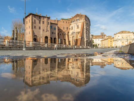 Rome, Italy - in Winter time, frequent rain showers create pools in which the wonderful Old Town of Rome reflects like in a mirror. Here in particular the Theater of Marcellus