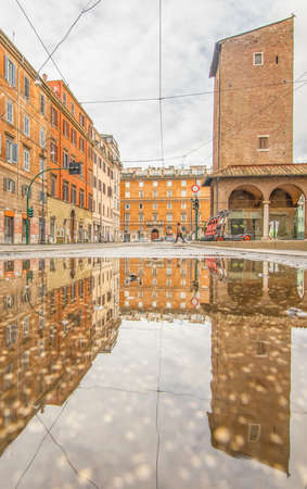 Rome, Italy - in Winter time, frequent rain showers create pools in which the wonderful Old Town Rome reflects like in a mirror. Here in particular the mirror effect