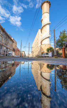 Rome, Italy - in Winter time, frequent rain showers create pools in which the wonderful Old Town of Rome reflects like in a mirror. Here in particular Via Giolitti