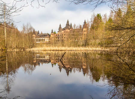Łapalice, Poland - built in 1983 but never finished, the ruins of Łapalice Castle are an interesting tourist attractions in northern Poland. Here in particular its shape reflecting in the nearby lake