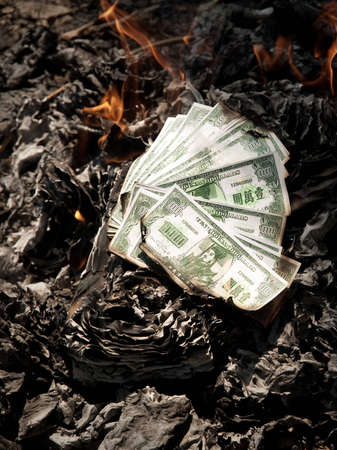 burning the chinese paper ghost money  become to be ash Stock Photo