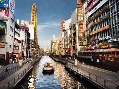 osaka: tour boat on Dotonbori river in Osaka Namba ,Japan Editorial