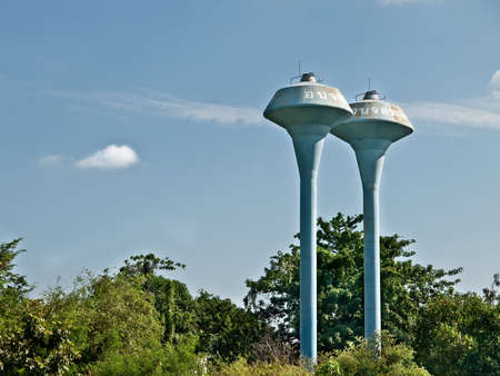 blue sky view of blue water tank stand in the forest in suburb Thailand