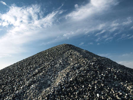 pile stone isolated on cloudy sky background