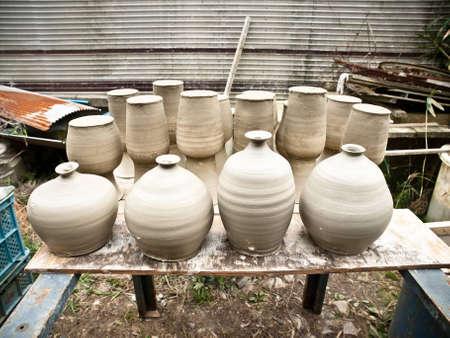 group of wet clay ceramic vases
