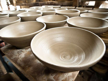 group of wet clay ceramic dishes Stock Photo