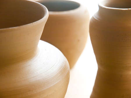 group of biscuit-fired ceramic vases