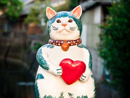 ceramic cat holding red heart