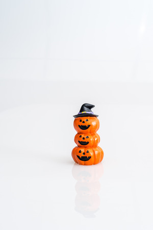 tripple: Halloween pumpkin witch hat on white background isolated Stock Photo