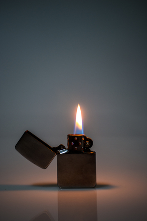 ambient: vintage used lighter flame fire hot in ambient light