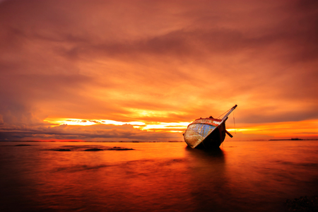 beached: The wrecked ship sunset, Thailand Stock Photo