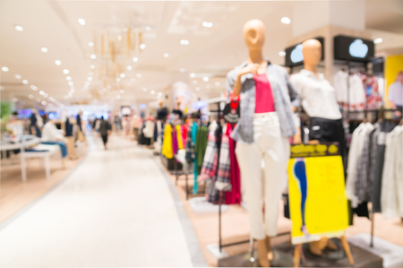 Abstract Blur Background of Women's Clothing Department with Model display in Shopping Mall or Department store as Women Shopping Concept 免版税图像