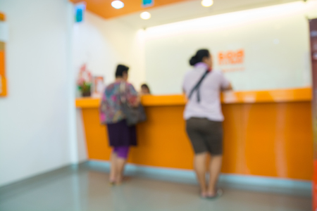 Abstract Blur Background of People, Woman or Female, making Transaction at counter as Financial Bank and Finance Concept 免版税图像 - 79324579