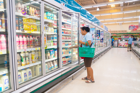 Nakhon Ratchasima, Thailand – June 20, 2017 : Unidentified Asian Woman selecting Dairy Product, Milk or Yogurt, from Fridge or refrigerator in Supermarket or Shopping Center in Thailand.