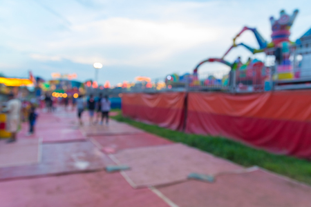 Abstract Blur or Defocus Background image of People, Male Female and Kids, Walking around in Local Amusement Fun Park or Fun Fair in Thailand at Twilight. 免版税图像 - 86872336