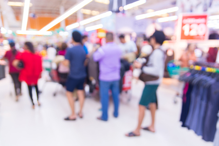 Abstract Blur Defocus Bokeh Background of People Shopping in Supermarket or Shopping Mall at Clearance Sale Corner on Weekend.