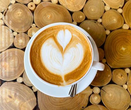 Hot coffee latte with beautiful heart latte art