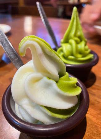 Matcha ice cream and milk ice cream.