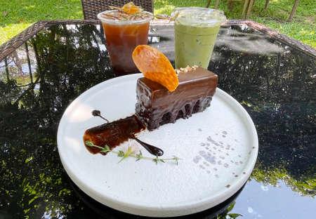 Black coffee with honey and lemon, Ice matcha green tea and chocolate cake.