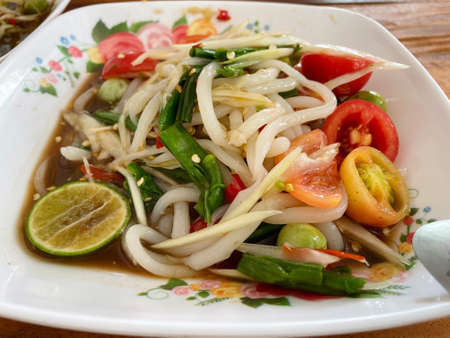Papaya Salad with rice noodle and Fermented Fish.
