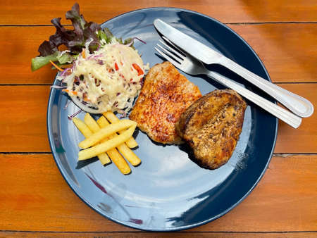 Combo chicken steak with french fries and salad.