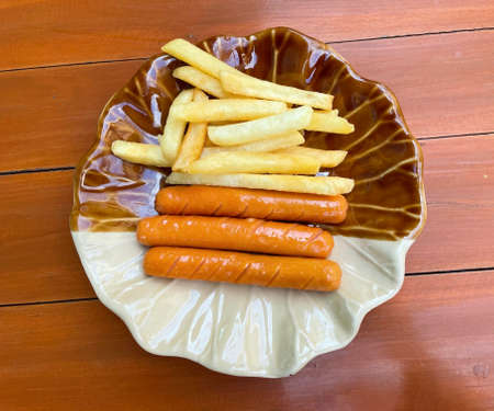 Chicken sausages and french fries