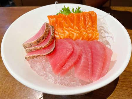 A famous Japanese menu is salmon sashimi and tuna sashimi.