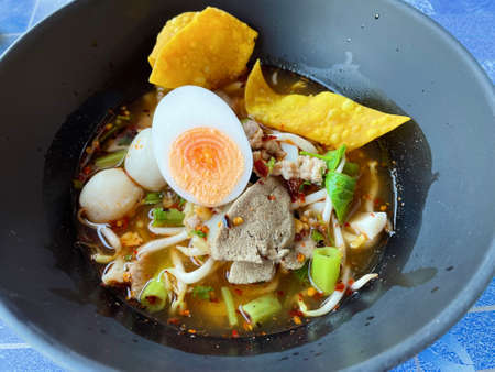 Tom yum pork noodle with boiled egg