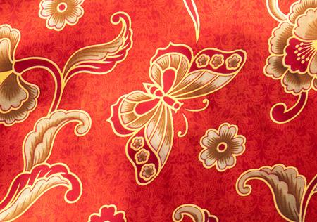 Close-up Butterfly pattern on red batik photo