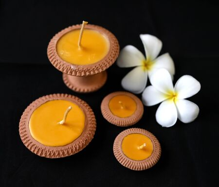 plumeria flower: Natural product the clay candle with the plumeria flower at the background