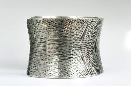 armlet: silver bracelet on the side
