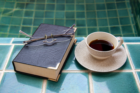 pool side: Coffee and book at the pool side