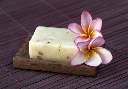 Natural handmade soap on wood floor background