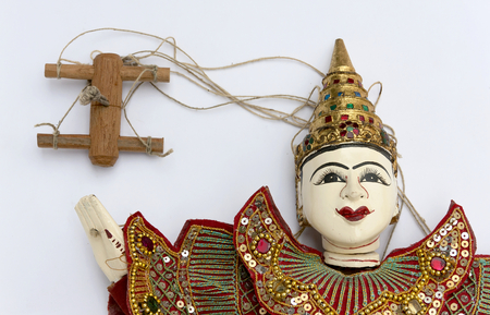 puppet master: Burmese puppet with rope on white background