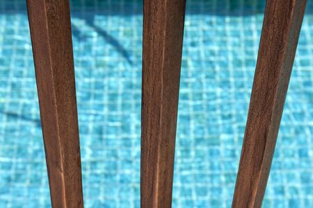Closeup Swimming pool and wooden fence background photo