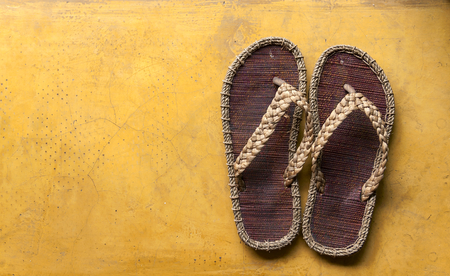 cement floor: Handmade sandals on yellow cement floor