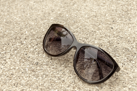 stone floor: Sunglasses on stone floor vintage tone style with space on the left Stock Photo