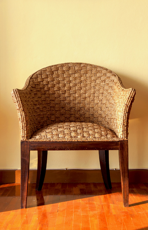 yellow wall: Wooden chair with yellow wall