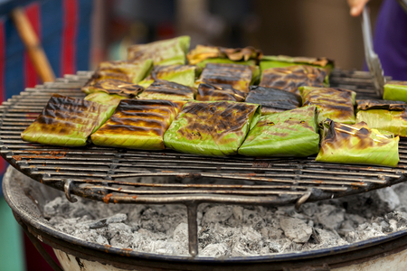 Thai style grill in banana leaf at the market